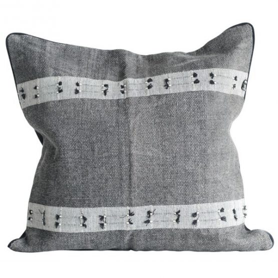 Gray throw pillow with white stripes and black tassels