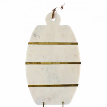 White marble oval cheese board with brass stripes