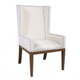 White wingback chair with cowhide seat cushion
