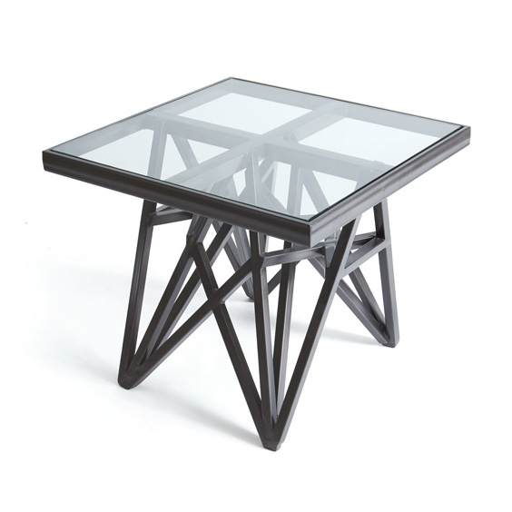 Contemporary side table with metal geometric base and glass top