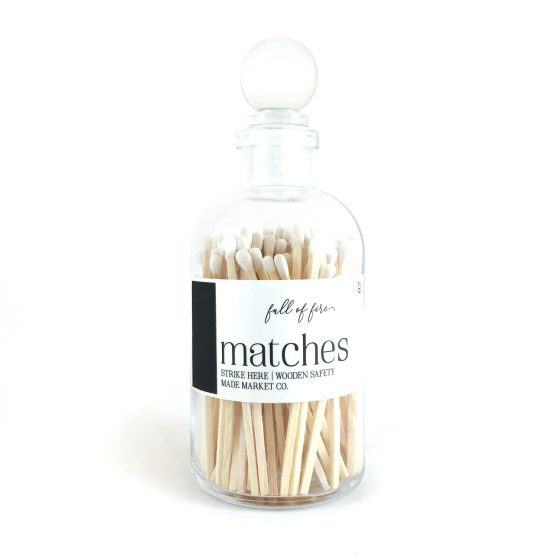 White wood matches in glass bottle