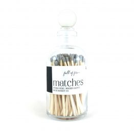 Gray wood matches in glass bottle