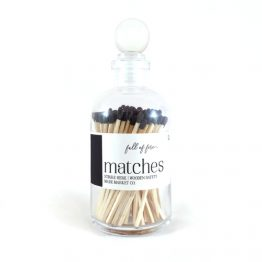 Black wood matches in glass bottle