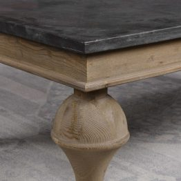 Bluestone coffee table on a whitewashed base with hand-turned legs