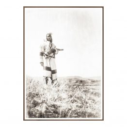 Portrait photograph of Native American in open plains