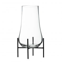Curved glass vase in black metal stand