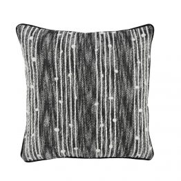 Black And White Patterened Pillow With White Knobs