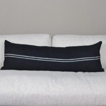 black lumbar pillow with two thin white stripes