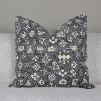 gray pillow with hieroglyphics print pattern