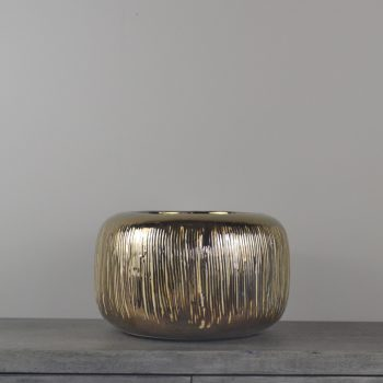 brown metallic glazed ceramic pot with white striped etchings