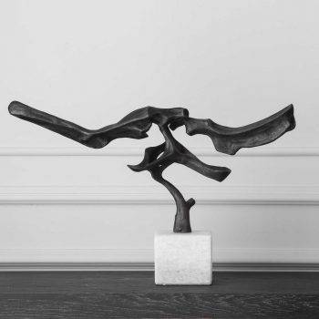 horizontal black metal architectural sculpture on white marble base