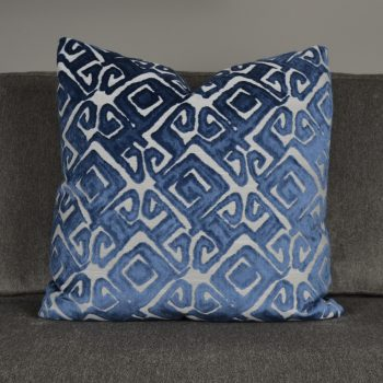 blue and white textured pattern pillow