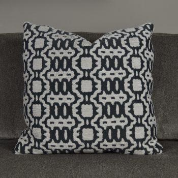 dark gray pillow with white textured pattern
