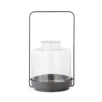 black metal lantern with glass hurricane