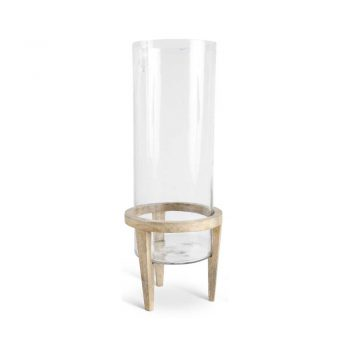 clear glass hurricane on light wood base